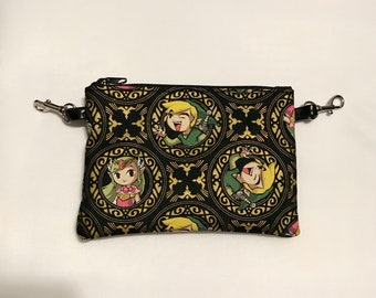 Small zippered bag made with gold Zelda Windwaker fabric