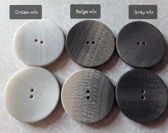 with golden central circles Beautiful gray marbled buttons