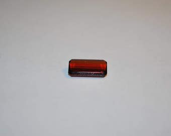 7.3 x 13.5 (4.25cts) Medium/Dark Red Orange Emerald Cut Spessartite Stone