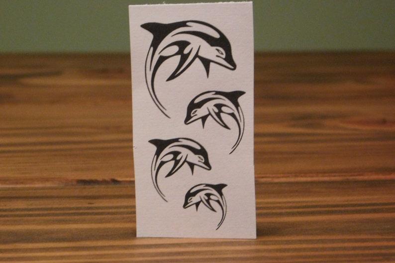 15. Tribal Temporary Dolphin Tattoos