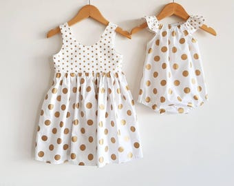 Sisters matching outfits // girls // playsuit // dress // romper // white // gold // spotted // polka dot // Christmas // occassion