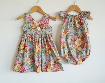 Sisters matching outfits // girls // playsuit // dress // romper // grey // pink // floral // special occasion