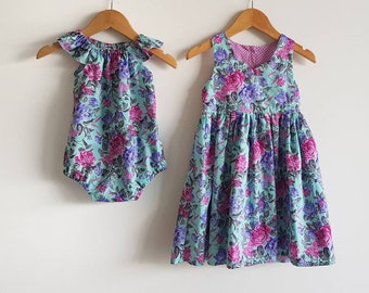 Sisters matching outfits // girls // playsuit // dress // romper // aqua // pink // purple // floral // special occasion