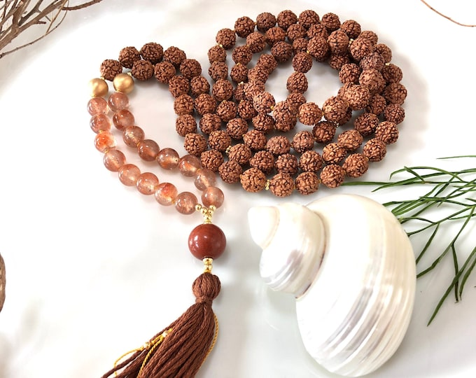 Mala in rudraksha and rutile quartz red, final pearl in red jasper, necklace with tassel of 108 pearls
