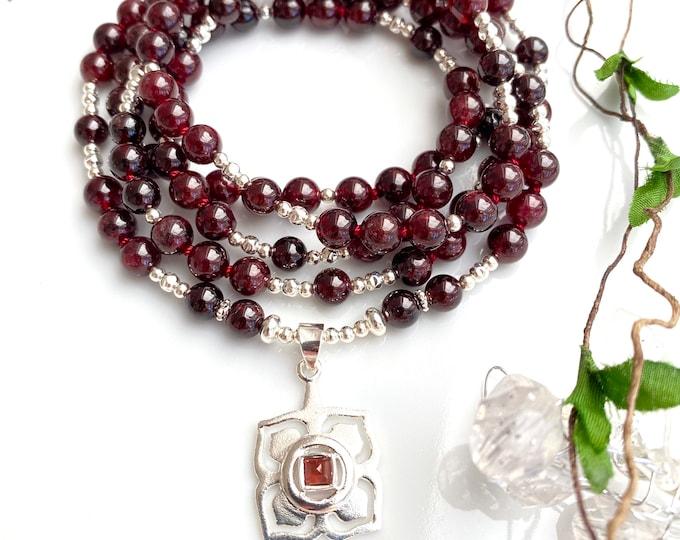 Mala made of garnet red (A) and silver pendant with root - chakra - symbol - Muladhara - chakra