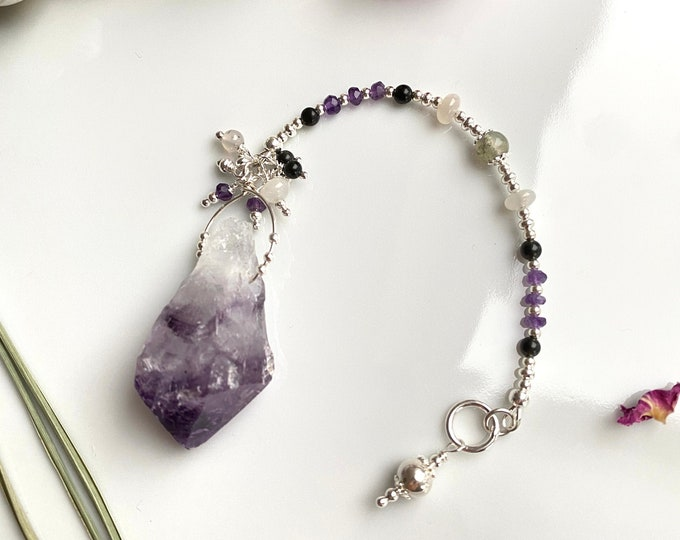 Pendulum of raw amethyst with silver, moonstone, rainbow obsidian, moss agate and amethyst