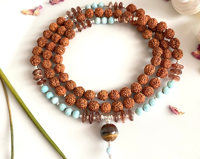 Mala from Larimar, Sunstone and Rudraksha, decorated with silver, final pearl tiger eye and Larimar