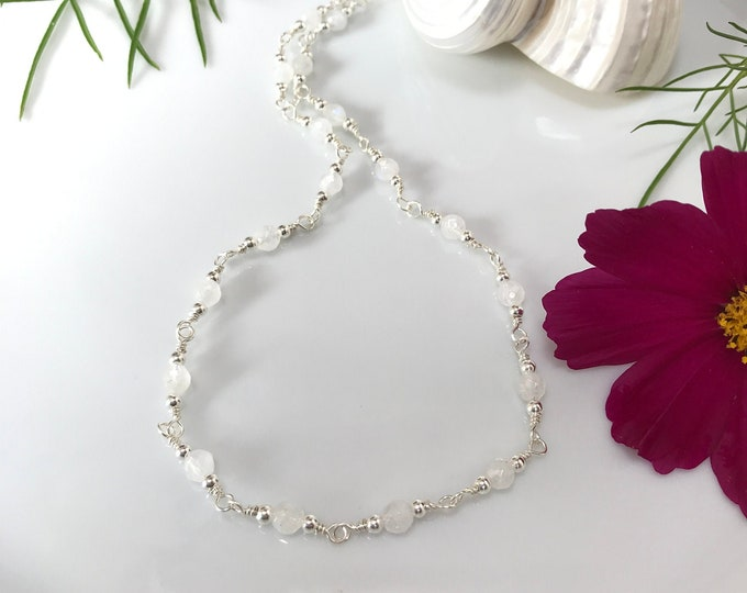 Short necklace, collier of white, faceted Labradorite beads (AA), wrapped on silver