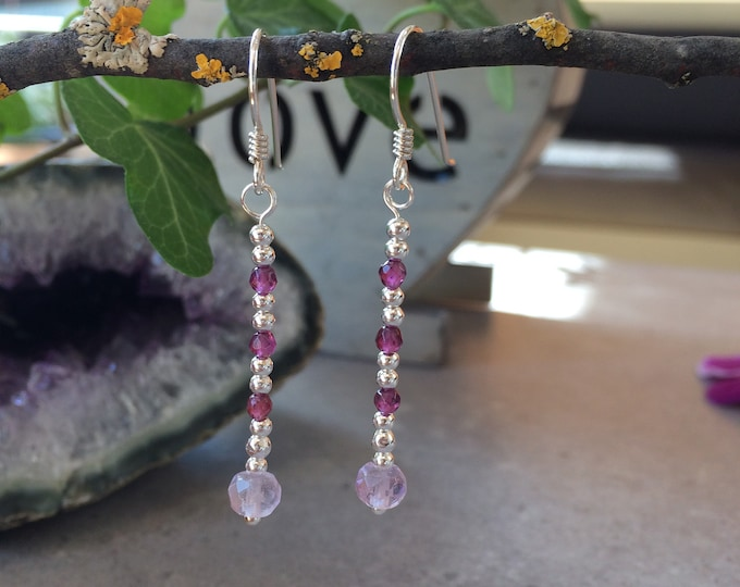 Silver earrings with amethyst light, faceted and garnet red