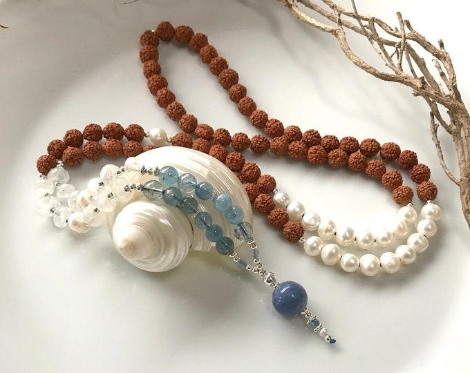 Mala from Rudraksha, freshwater pearls, white labradorite and aquamarine, final pearl in blue quartz