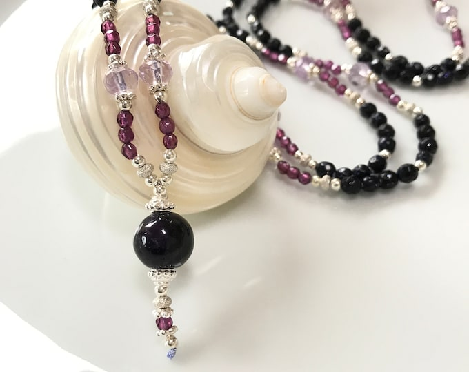 Petite mala of gold flow violet and ametrin, decorated with silver and garnet violet, final bead of amethyst