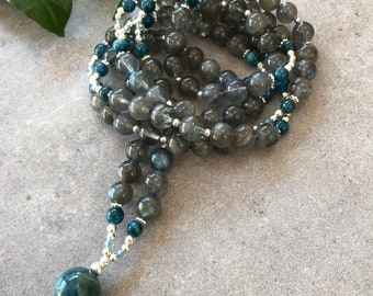 Mala from labradorite dark and apatite blue, decorated with silver, final pearl of apatite Blue