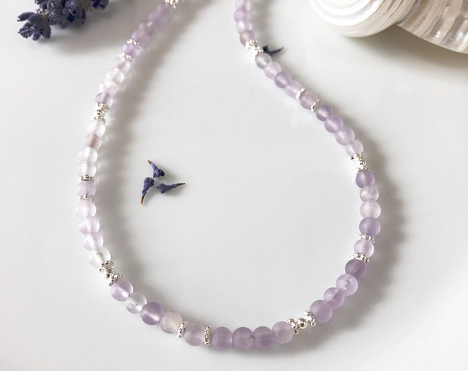 Petite necklace made of amethyst bright, matted, decorated with silver