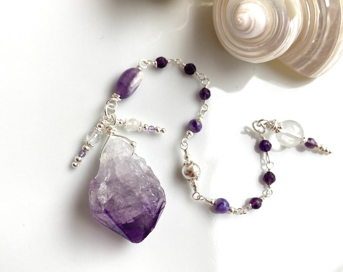 Pendulum made of raw amethyst with silver, charoite and rock crystal