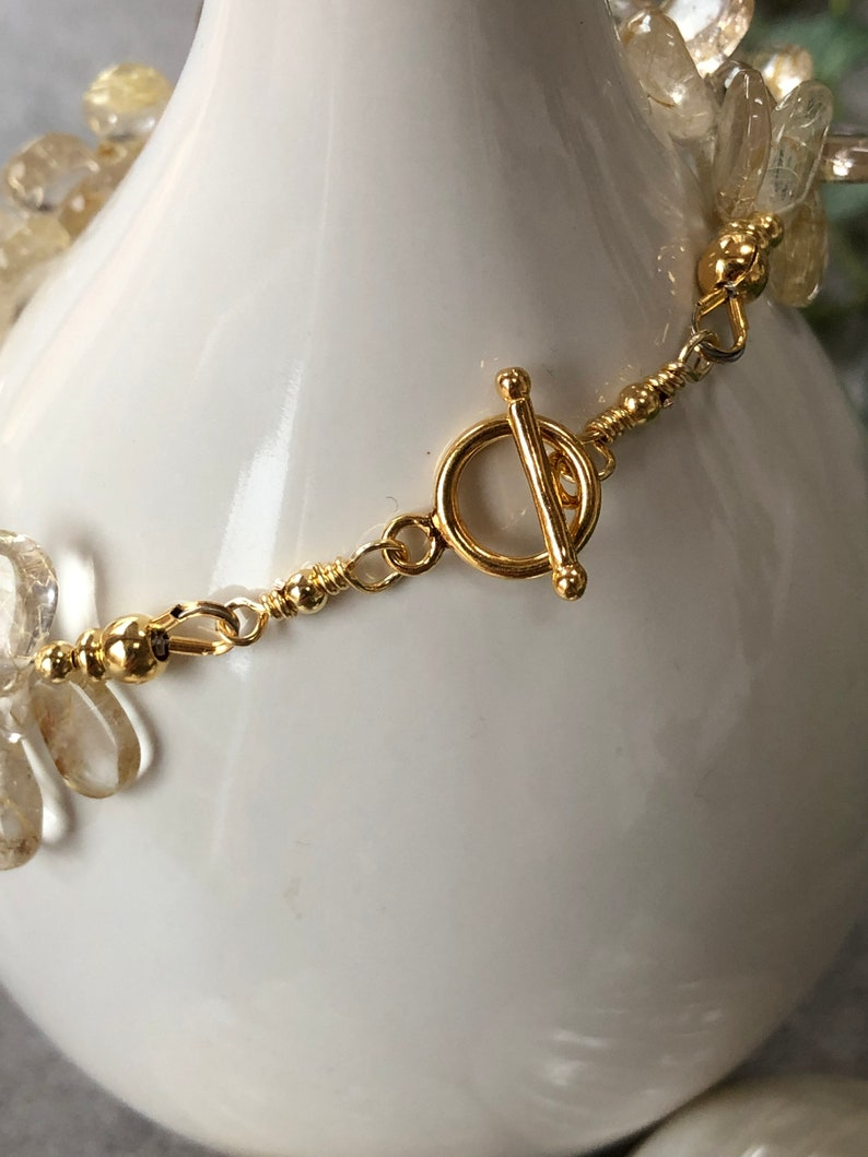 Bracelet in ruler quartz clear with silver gold plated