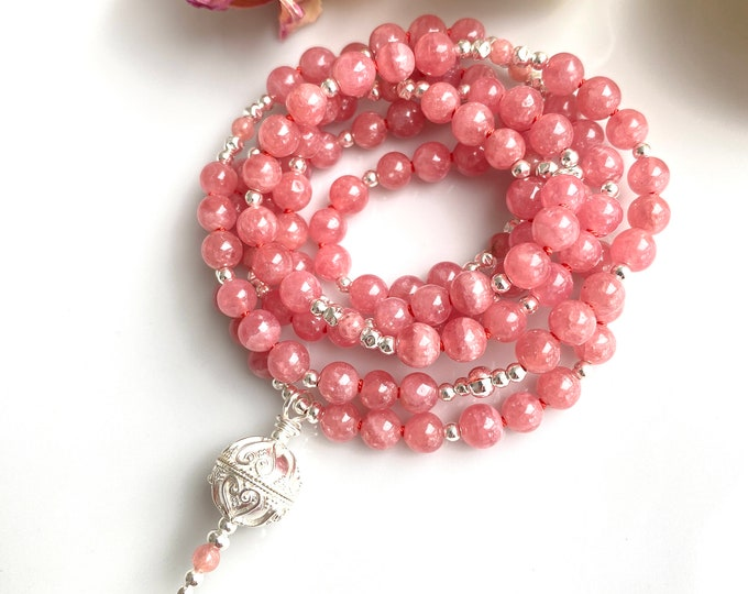 Noble mala made of rhodochrosite (AA), decorated with silver, final pearl with ornaments in silver