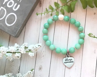 Choose Happiness mantra charm on green chalcedony bracelet. Bracelet is stretch.