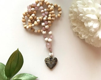 108 bead meditation mala, diffuser necklace hand knotted with rose quartz guru bead and brass diffuser for essential oils. Heart diffuser.