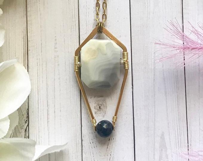 Botswana agate pendant necklace with dumortierite
