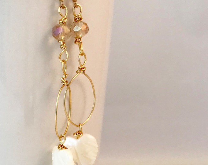 Long dangle, crystal and mother of pearl earrings.