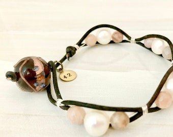 Freshwater pearls and moonstone bracelet. Clasp made from vintage lampworked bead. Leather cord