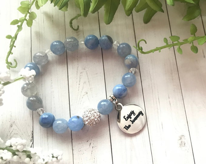 Mantra charm bracelet with blue agate beads