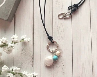 Hand hammered choker necklace with sterling silver pendant with turquoise, and freshwater coin pearl drops, leather cord