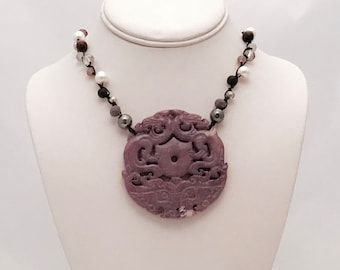 Hand knotted necklace with carved jade pendant. A gorgeous modern, boho luxe, statement necklace. OOAK gift for women
