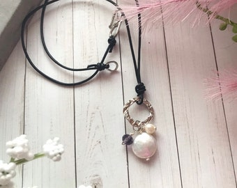 Hand hammered sterling silver pendant with amethyst, freshwater pearl and coin pearl drops, leather cord