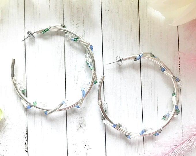 Large hoop earrings with crystals and blown glass beads