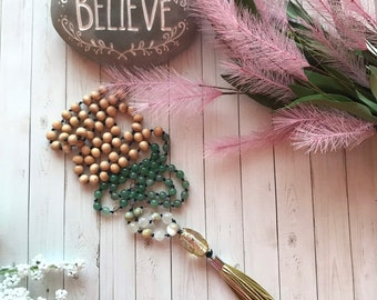 108 bead meditation mala with leather tassel. Handknotted with white mountain jade, jasper, adventurine and white wood beads
