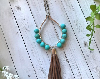 Turquoise tear drop necklace with leather tassel