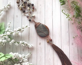 Crocheted beaded necklace with wire wrapped river agate pendant and long leather tassel. A statement necklace