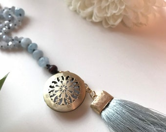 108 bead meditation mala - handknotted with aquamarine beads and blue crystal beads. Brass diffuser with a silk tassel