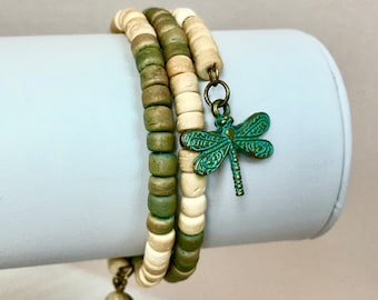 Wrap bracelet made with vintage wood beads. Your choice of a dragonfly charm or a feather charm. Bracelet is adjustable