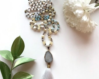 108 bead meditation, handknotted with druzy pendant and amazonite and howlite beads. Necklace has a white silk tassel