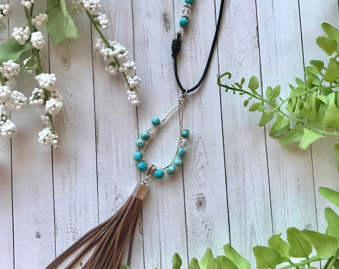 Turquoise drop pendant with leather tassel
