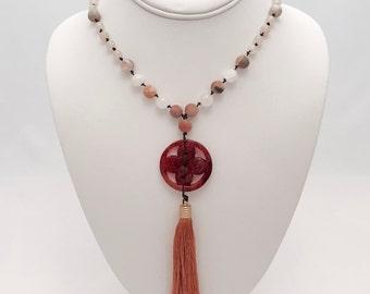108 bead meditation mala. Handknotted amazonite and white mountain jade beads. Jade pendant with silk tassel.