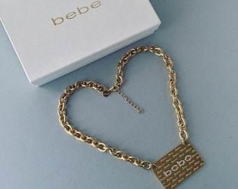 Like New BeBe Amor, Amore, Amour Love Gold Tone and CZ Sweethearts Necklace in Gift Box