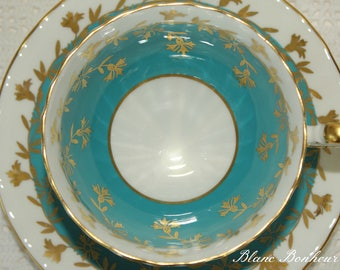 Aynsley, England: Turquoise tea cup & saucer with gold gilding