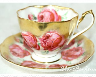 Queen Anne, England: Tea cup & saucer with gilding and big roses