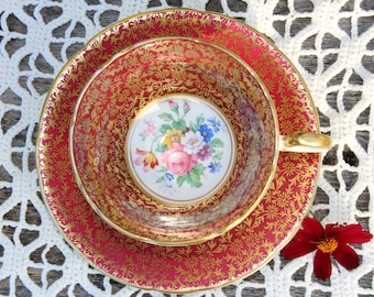 Aynsley: Footed tea cup and saucer, burgundy red, gold and white