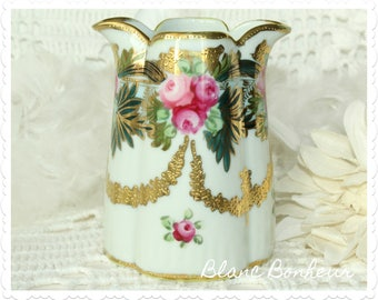 Nippon, Japan: Hand painted double spout creamer, with moriage