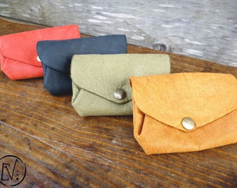 Eco leather with three compartments, tanned, pigments, labeled leather, snap closure wallet