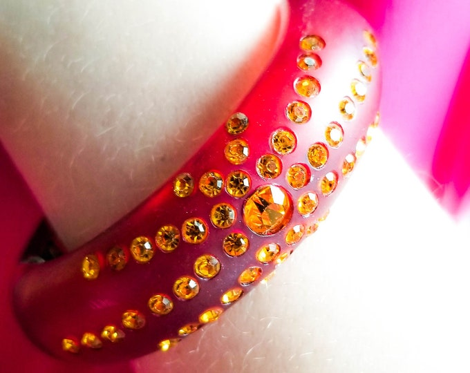 Stunning Red Amber Acrylic Bangle with Center Amber Stone and Radiating Amber Bands of Stone
