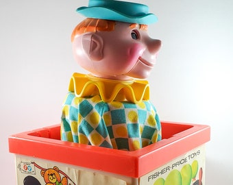 Vintage Fisher Price  Plastic Toy Clown Jack in the Box in Bright Red. With sound!