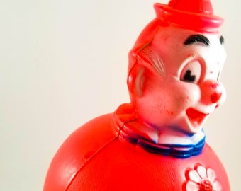 Vintage Wobbly Roly Poly Plastic Toy Clown in Bright Red. Wobbles but won't Fall down! With Tinkling Sound.