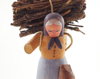 Vintage carved folk Art figure -Canadian Traditional Quebec Hand Carved wood Folk art , Painted Old Woman with Wood Pile