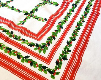 """Gorgeous Festive 1960's Christmas Cotton/Linen Tablecloth with Ribbon and Poinsetta leaves and Berries, 59""""L x 48.5""""W"""