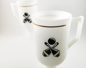 Set of 2 Milk Glass Pedestal Mugs with D-handles and Bowling Motif with gilt banding